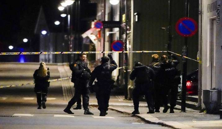 Police stand at the scene after an attack in Kongsberg,
