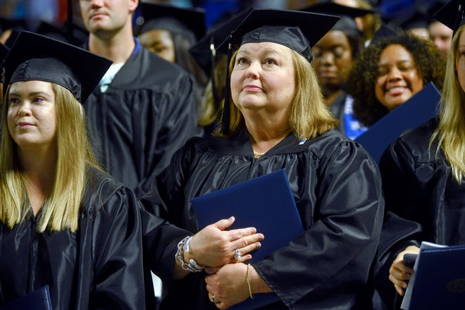 Students at a recent Middle Tennessee State University commencement. The federal government is preparing to forgive student loans of more borrowers who are employed in public service jobs such as teaching.