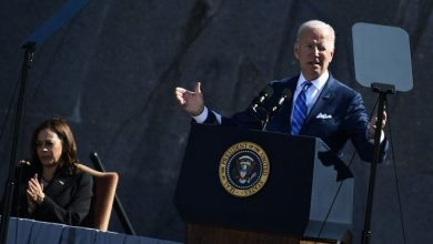 US President Joe Biden, with Vice President Kamala Harris, speaks at a ceremony marking the 10th Anniversary dedication of the Martin Luther King, Jr., Memorial, in Washington, DC, on October 21, 2021. (Photo by BRENDAN SMIALOWSKI/AFP via Getty Images)