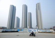 China says will roll out property tax pilot scheme in some regions