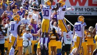 LSU wide receivers Jaray Jenkings (10) and Malik Nabers celebrate during the team's defeat of Florida at Tiger Stadium in Baton Rouge.