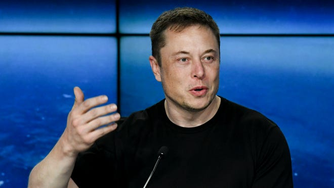Elon Musk gives Jeff Bezos silver medal as his richest man lead builds