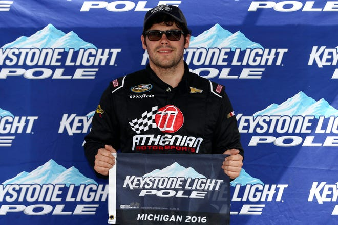 John Wes Townley, shown here on Aug. 27, 2016 after winning the pole for the NASCAR Truck Series race at Michigan International Speedway.