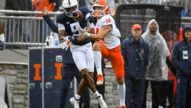 Penn State Nittany Lions cornerback Tariq Castro-Fields (5) breaks up a pass intended for Illinois Fighting Illini wide receiver Casey Washington (14) during the first half at Beaver Stadium.