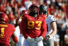 Iowa State junior defensive tackle Isaiah Lee reacts after stopping Oklahoma State senior running back Jaylen Warren in the backfield for a loss of yards in the second quarter at Jack Trice Stadium.