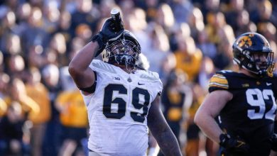 Purdue offensive lineman Greg Long pours a can of Bud Light over his face after a fan at Iowa's Kinnick Stadium tossed the beer onto the field in the third quarter.
