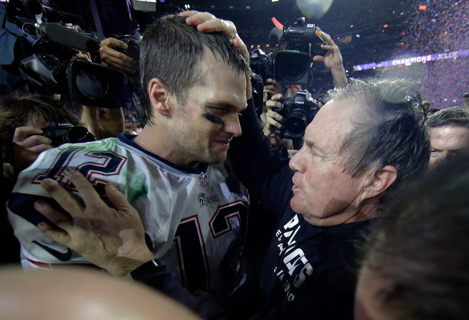 In this Feb. 1, 2015, file photo, New England Patriots quarterback Tom Brady celebrates with head coach Bill Belichick after winning NFL Super Bowl XLIX football game against the Seattle Seahawks  in Glendale, Ariz.