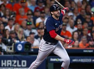 Red Sox designated hitter J.D. Martinez hits a grand slam in the first inning against the Astros.