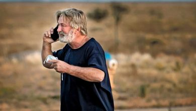 """Alec Baldwin speaks on the phone in the parking lot outside the Santa Fe County Sheriff's Office in Santa Fe, N.M., after he was questioned about a shooting on the set of the film """"Rust"""" on the outskirts of Santa Fe, Thursday, Oct. 21, 2021. Baldwin fired a prop gun on the set, killing cinematographer Halyna Hutchins and wounding director Joel Souza, officials said."""