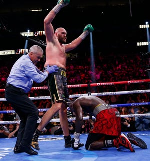 Tyson Fury knocks down Deontay Wilder and remains heavyweight champion with 11th-round TKO victory.