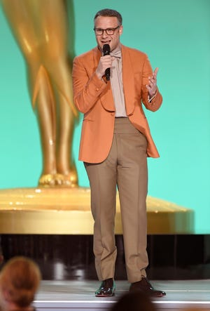 """Seth Rogen, seen here presenting outstanding supporting actress in a comedy at the 73rd Emmy Awards, has spoken out in support of unionized Hollywood workers. """"Our films and movies literally would not exist without our crews, and our crews deserve better,"""" he tweeted."""