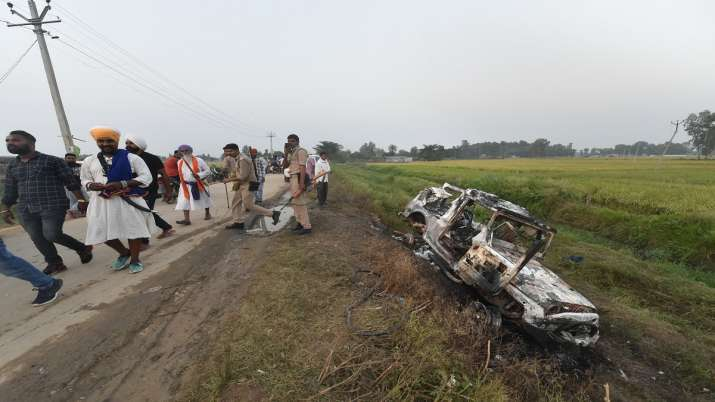 People take a look at the overturned SUV which destroyed in